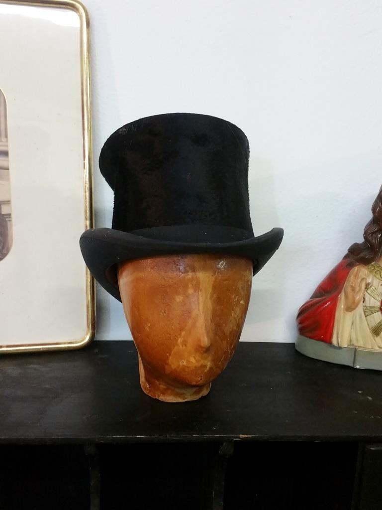 1 tete et chapeau haut de forme