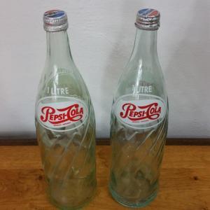 2 bouteuilles de pesi cola
