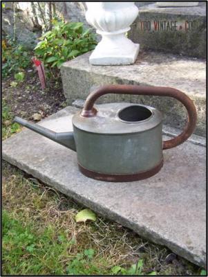 Ancien arrosoir en zinc